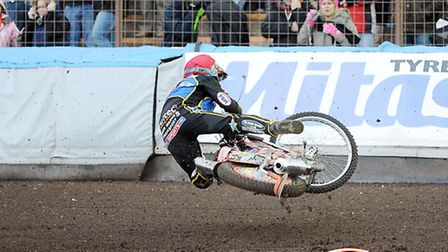 Action from King's Lynn Stars v Poole at the Norfolk Arena - Mads Korneliussen takes a tumble in Hea