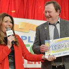 Pictured is the Peoples Postcode Lottery winners in Sidmouth receiving their cheques as East Devon w