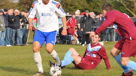 Wroxham's Ben Lewis on the ball during his side's semi-final against Spixworth. Picture: Simon Finla