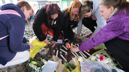 Friends gather at North Walsham market cross in memory of one year old Ryan Wright, who has lost his