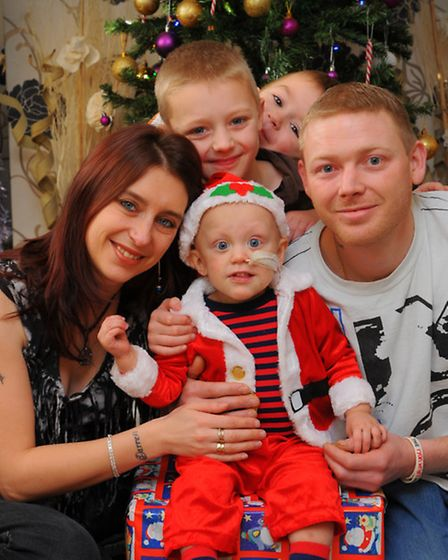 Ryan Wright with his parents Hayley and Darren and brothers Keenan and Ethan at Christmas last year.