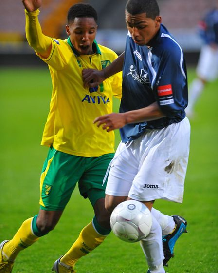 Wroxham, blue, in action against Norwich City Under-21s last night. Picture: Steve Adams