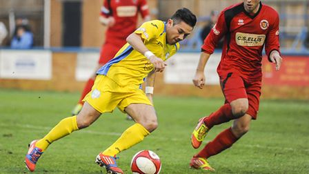 Steve Spriggs, pictured here playing against Stamford, will be a King's Lynn Town player again next