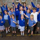 Otterton Primary school children celebrate their recent Ofsted report. Ref exb 19 17TI 3105. Picture