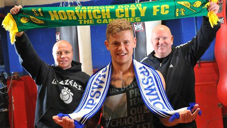 Billy Bird shows his colours at the Kickstop Gym with trainers Jon Thaxton and Graham Everett. Pictu
