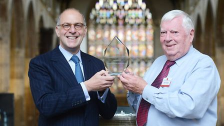 Brian Chase receives his recognition award from Loyd Grossman inside St Nicholas Chapel. Picture: Ia