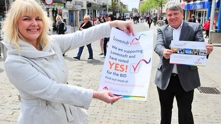 Emma King and Danny Steel (centre) with the 'Yes' posters.