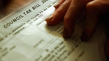 Library filer dated 20/02/2005 of a someone examining her council tax bill. More than two million ho