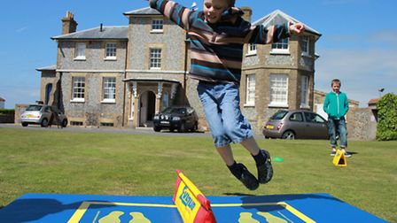 Six-year-old Ralph Plummer joining in village games hosted by Active Norfolk as part of a coronation