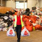 A Salvation Army worker collecting bags of donated textiles. Picture by EDDC.