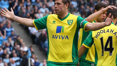 Grant Holt celebrates his goal in the 3-2 win over Manchester City. Picture: Paul Chesterton / Focus