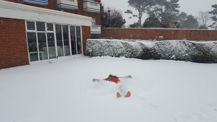 Alam who has never seen snow before dives right in! Devoncourt Hotel. Picture: Jamie Dawe - Asistant