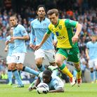 Jonny Howson runs through the Manchester City defence before scoring the winner in Norwich City's 3-