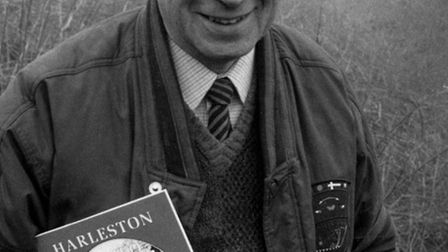 Sid Taylor, holding a copy of his book Harleston Cameo. Picture dated (library stamp, used) Feb 28,