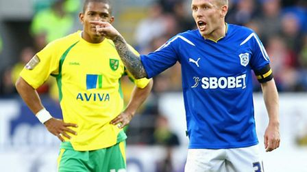 Craig Bellamy lets the referee know his feelings as Simeon Jackson watches on, during one of the fix