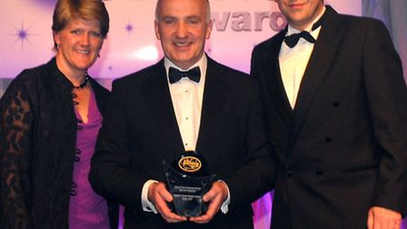 Paul Ostojic, centre, operations director of Gladwins Body Repair Centres, receives the Best for Cus