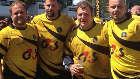 The West Norfolk rugby players who took part in the Scotty's Little Soldiers World Record match. (Fr