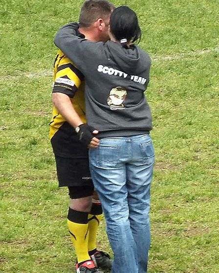 Simon Whittaker gets a hug from Nikki Scott, the founder of Scotty's Little Soldiers