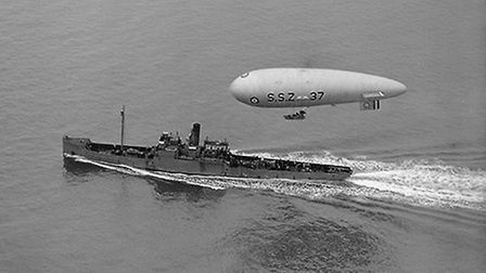 SSZ 37 flies above a minelaying sloop. Airships were ideal escort craft and could even be launched