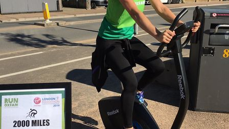 Debbie Newson taking part in a static cycle as part of her crusade to raise 2,000 for Oxfam. Picture