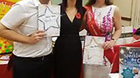Mark and Helen accepting their awards from Slimming World consultant Lisa Boucher.