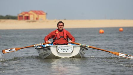 Simon Neale rowed from Wells Sailing Club to the Fairway buoy and back to raise money for three char