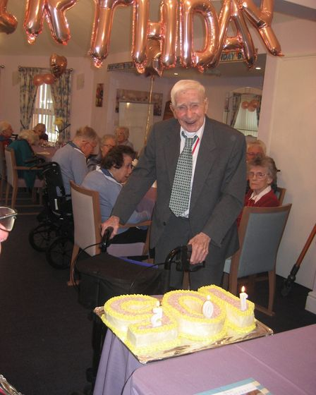Bill McGregor with his cake marking his 105th birthday. Picture: Abbeyfield Shandford