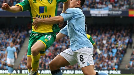 Wes Hoolahan escapes the clutches of Samir Nasri. Picture: Paul Chesterton / Focus Images