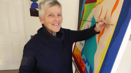 Artist Liz Cleves, working on a painting called Stellar Rising. Picture: Ivor Cleves
