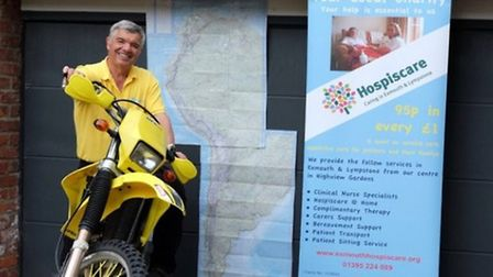 Phil Corcos on the bike he rode from Anchorage to Ushuaia. Picture: Hospiscare Exmouth and Lympstone