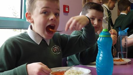 Youngsters at Withycombe Raleigh Primary School einjoying Indian cuisine. Picture: Withycombe Raleig
