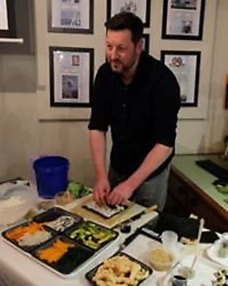 Simon Ridler from Fish on the Quay demonstrating Sushi preparation at the Exmouth Deep Sea Fishing C