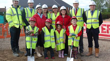 Students and staff from Peterhouse Primary School, from, join representatives from Norse Care, build