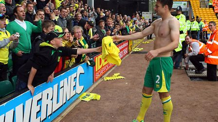 Russell Martin gives his shirt to a fan after City's triumphant final home match of the season again