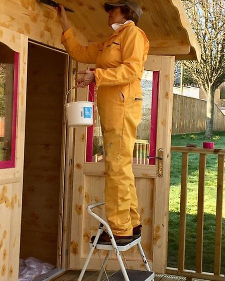 A new summer house at Age Concern Budleigh Salterton being painted. Picture: Age Concern Budleigh Sa