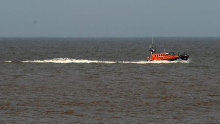 A lifeboat searches the North Sea at Southwold for the missing swimmer. Picture: Simon Parker