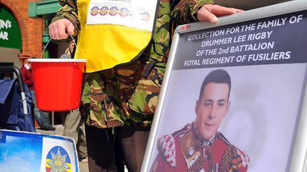 Richarrd Anderson collects money in memory of Drummer Lee Rigby outside the Castle Mall in Norwich.