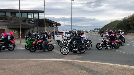 Some of the motorcyclists coming past Exmouth lifeboat station as they near the end of the Action on