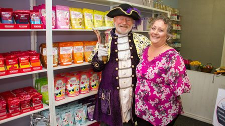 Frances Mellows with Exmouth Town Crier Roger Bourgein at the opening of her new cake shop. Ref exe