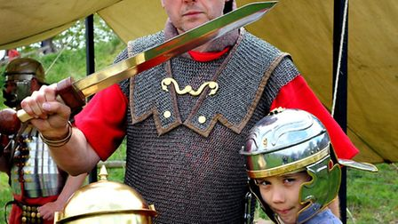 Sylvie and Theo Hewitt, of Swardeston, with Ian Pycroft of black knight historical at the Roman Day