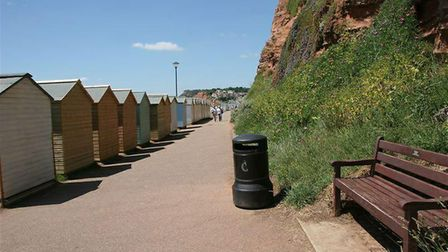 Beach huts lining Budleigh Salterton seafront