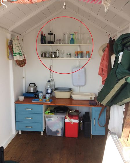 The crockery (circled) smashed to floor of the Jacksons' beach hut in Budleigh Salterton.