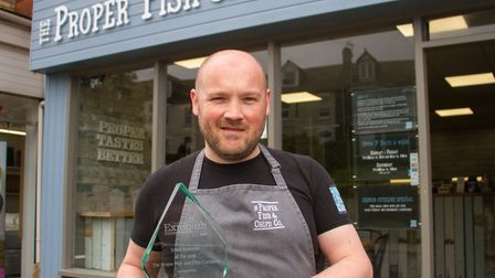 Danny Hennesy of The Proper Fish & Chips Co with his Exmouth Business Award. Ref exe 18 19TI 3646. P
