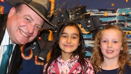 Andreas Yiasimi, who opened Cromer carnival art week, with youngsters at the Belfry school display.