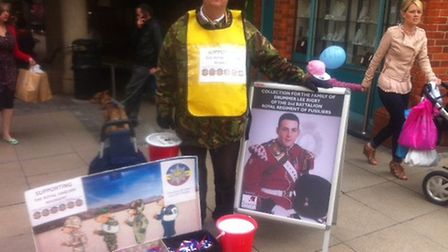 Fundraiser Richard Anderson collecting money in memory of Drummer Lee Rigby outside Castle Mall in N