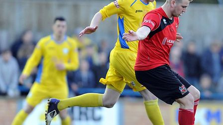 Dan Quigley, yellow, has become a real fans' favourite at King's Lynn Town. Picture: Matthew Usher.