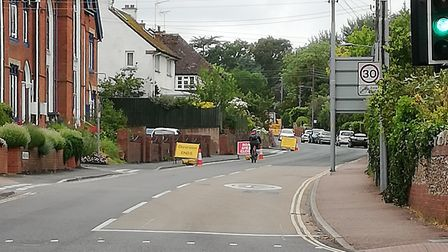 Barriers and road closure signs at the traffic lights on West Hill. Picture: Tom Cavanagh