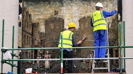 Work begins to restore John Moray-Smith's bas-relief of St Stephen's Gate. Photo: Bill Smith