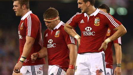 The dejected Lions of (right to left) Sam Warburton, Tom Youngs and Dan Lydiate after their second T