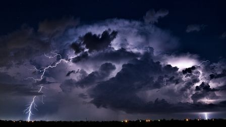 Thunderstorm illuminated by lightning. Picture: Getty Images